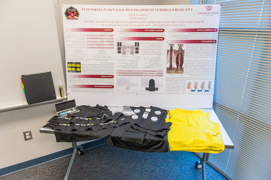 The TWU poster and garment prototypes presented at the spring Design Challenge for NASA.