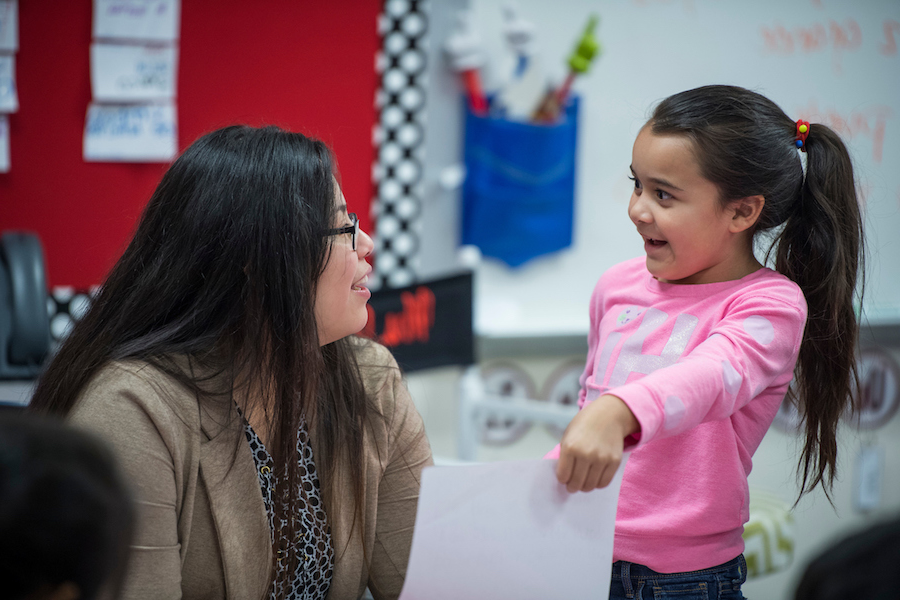 A TWU student works with a young child as part of the university's new biliteracy program