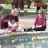 TWU students and their families involved in an activity at the fountain