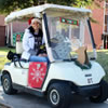 A TWU golf cart picks up donations on campus for the Holiday Gift program
