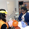 A TWU Nursing student and Kimberly Ramirez participate in a simulated emergency room