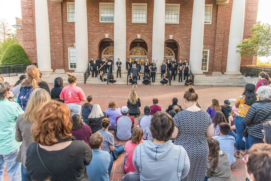 Singers and musicians perform on the TWU library steps in front of a crowd